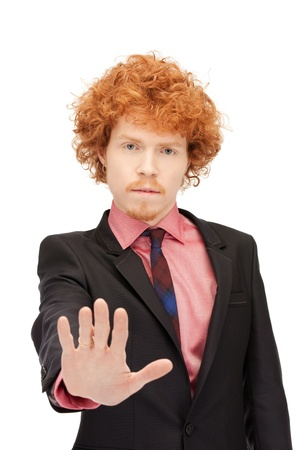 bright picture of young man making stop gesture Stock Photo - 9426481