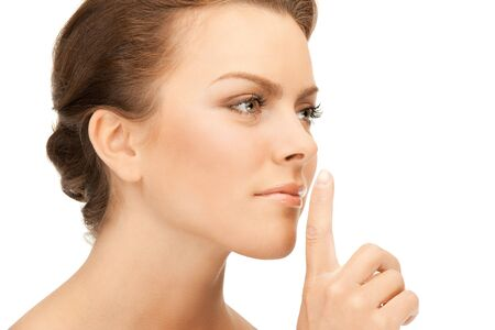 bright picture of young woman with finger on lips Stock Photo - 9439434