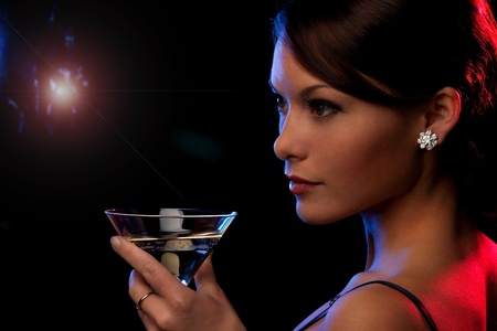 picture of beautiful young woman with a cocktail photo