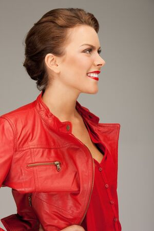 bright picture of lovely woman in red leather jacket Stock Photo - 9492350