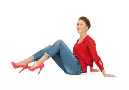 bright picture of lovely woman in red blouse and jeans photo