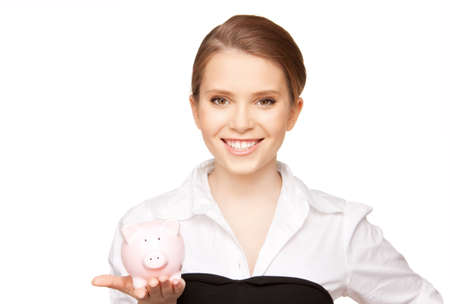picture of lovely woman with piggy bank Stock Photo - 9494272