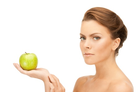 green apple: picture of young beautiful woman with green apple