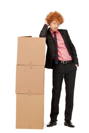 picture of attractive businessman with big boxes photo