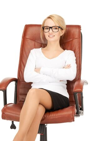 gorgeous businesswoman: picture of young businesswoman sitting in chair