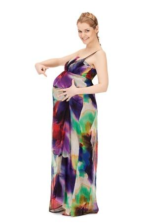 bright studio picture of beautiful pregnant woman photo