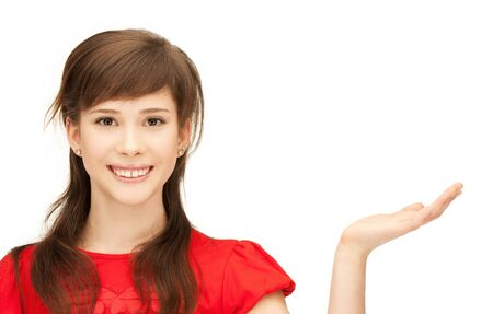 teenage girl showing something on the palm of her hand Stock Photo - 9604360