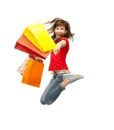 ni�os de compras: imagen de adolescente con bolsas de salto