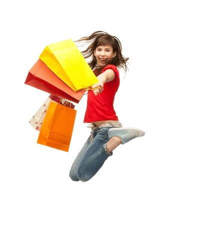 shoppers: picture of jumping teenage girl with shopping bags Stock Photo