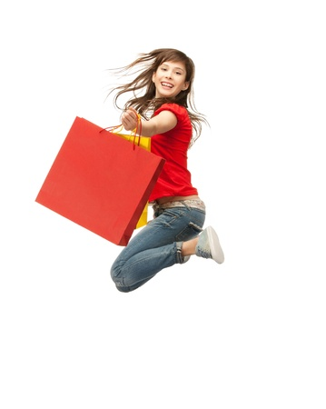 carrying girl: picture of jumping teenage girl with shopping bags Stock Photo