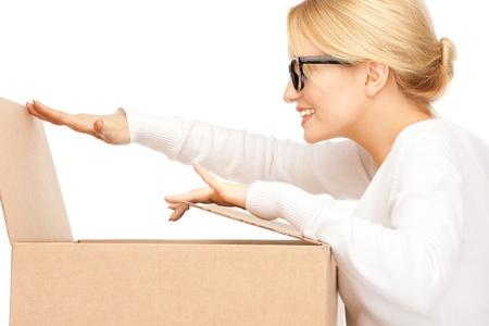 parcel service: picture of attractive businesswoman with cardboard box