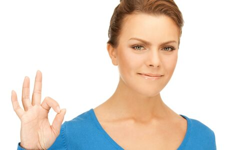 bright picture of lovely teenage girl showing ok sign Stock Photo - 9658865
