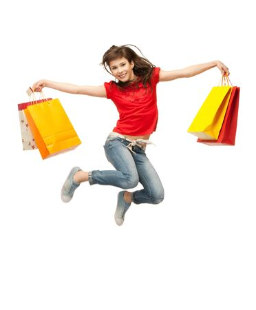 woman holding bag: picture of jumping teenage girl with shopping bags Stock Photo