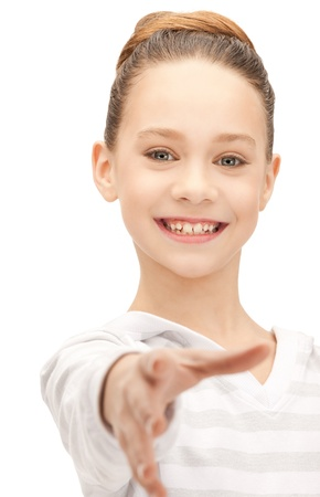 cute teen girl: picture of teenage girl with an open hand ready for handshake Stock Photo