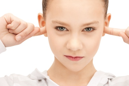 picture of teenage girl with fingers in ears photo