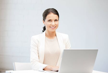 picture of happy woman with laptop computer Stock Photo