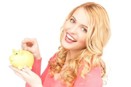 earn: imagen de mujer encantadora con hucha y dinero