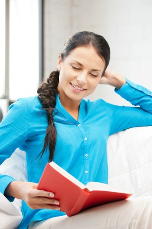 bright picture of happy and smiling woman with book Stock Photo - 9846701
