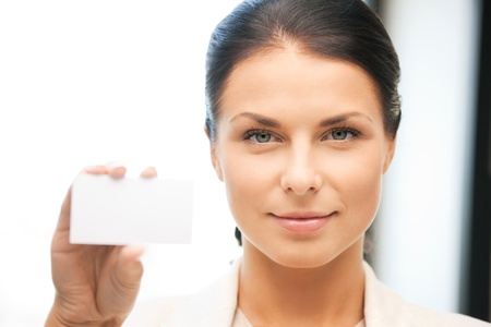 bright picture of confident woman with business card Stock Photo - 9846739