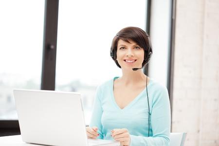 helpline: picture of helpline operator with laptop computer