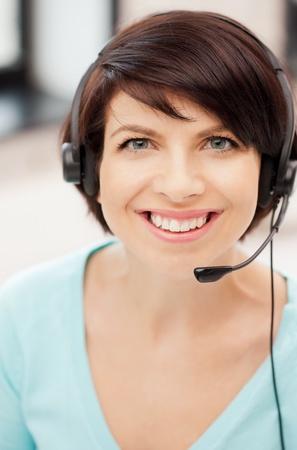 call center female: bright picture of friendly female helpline operator
