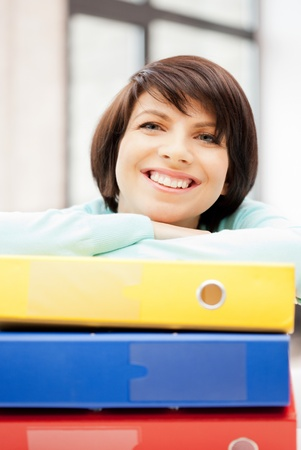 bright picture of beautiful woman with folders photo