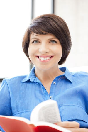 bright picture of happy and smiling woman with book Stock Photo - 9905419