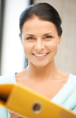 bright picture of beautiful woman with folder Stock Photo - 9905432