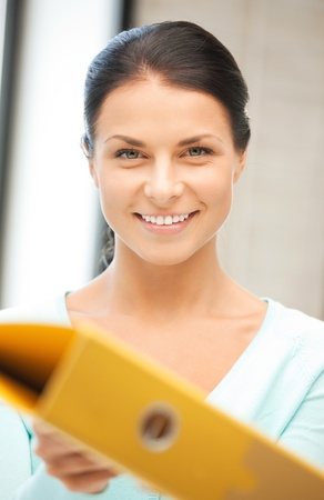 bright picture of beautiful woman with folder Stock Photo - 9905488