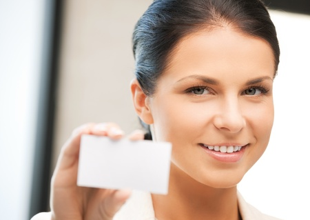 bright picture of confident woman with business card Stock Photo - 9905457