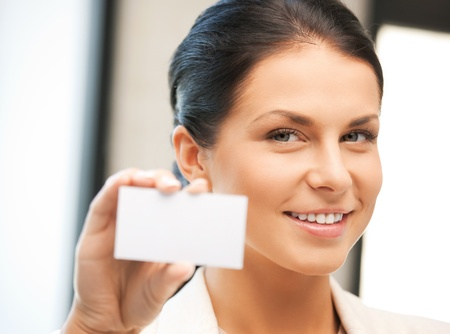 bright picture of confident woman with business card Stock Photo - 9905536