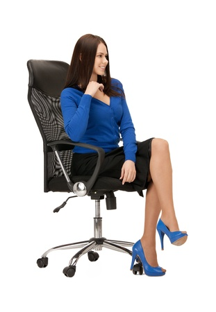 people sitting: picture of young businesswoman sitting in chair