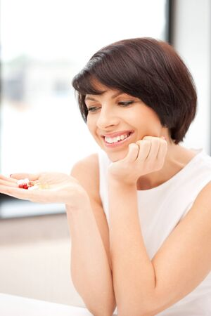 picture of young beautiful woman with pills Stock Photo - 9996582