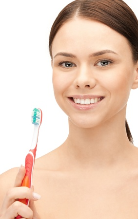bright closeup portrait picture of beautiful woman with toothbrush photo