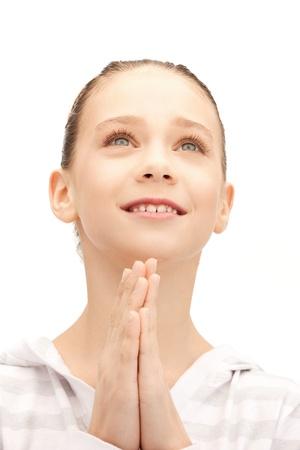 faithful: bright closeup portrait picture of praying teenage girl