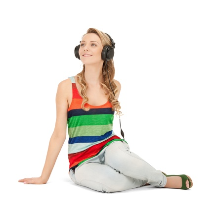 picture of happy teenage girl in big headphones Stock Photo - 10060985