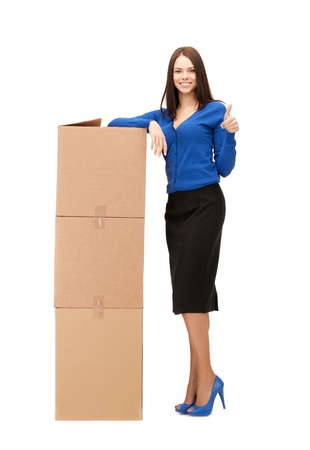 carton box: picture of attractive businesswoman with big boxes Stock Photo