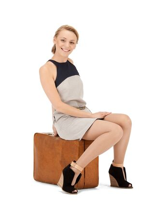 bright picture of lovely woman with suitcase Stock Photo - 10082072