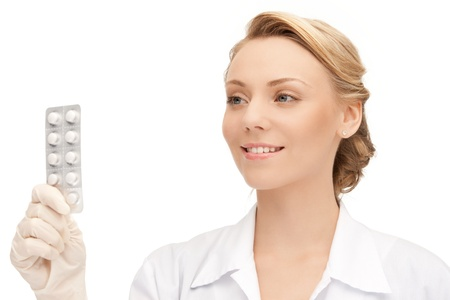 painkiller: picture of attractive female doctor with pills
