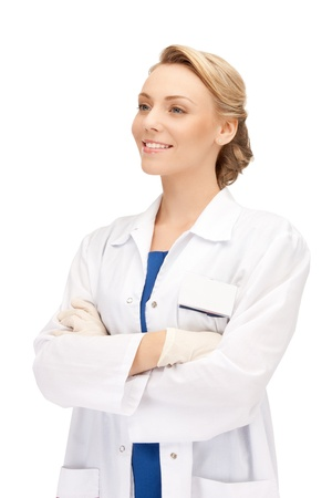 dentist at work: bright picture of an attractive female doctor