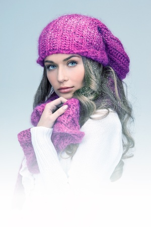 muffler: blue-toned picture of beautiful woman in winter hat