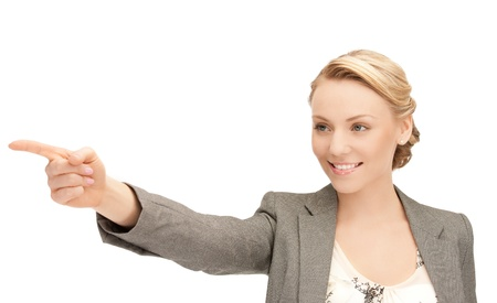 woman pointing: picture of attractive businesswoman pointing her finger