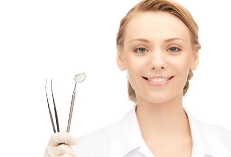 stomatologist: picture of attractive female dentist with tools