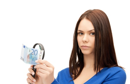 spurious: beautiful woman with magnifying glass and euro cash money Stock Photo