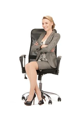 persona sentada: imagen de joven empresaria sentado en silla Foto de archivo