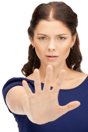to restrain: bright picture of young woman making stop gesture Stock Photo