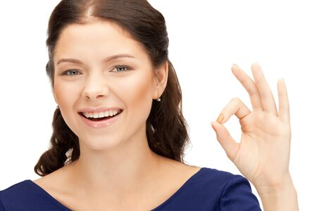 bright picture of lovely teenage girl showing ok sign Stock Photo - 10465416