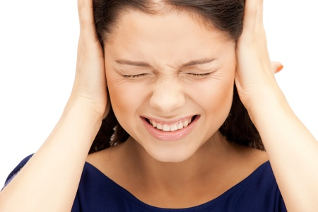 misery: picture of woman with hands on ears