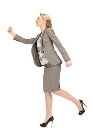 bright picture of happy and smiling walking woman Stock Photo - 10550063