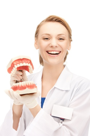 stomatologist: picture of attractive female doctor with jaws